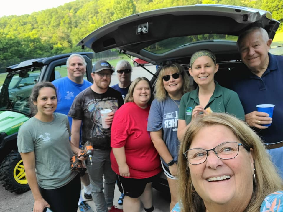 Kiwanis Club of East Fork Members with Clermont County Park representative, preparing the Sycamore Park Story Book Walk.