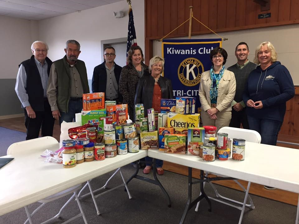 Club members with food pantry donation